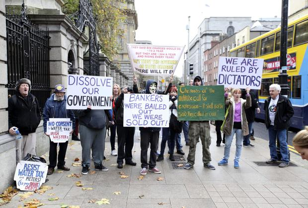 Protesters pictured outside Leinster House in Dublin. Stephen Collins/Collins Photos