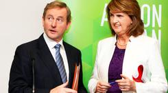 Enda Kenny and Joan Burton. Photo: Tom Burke