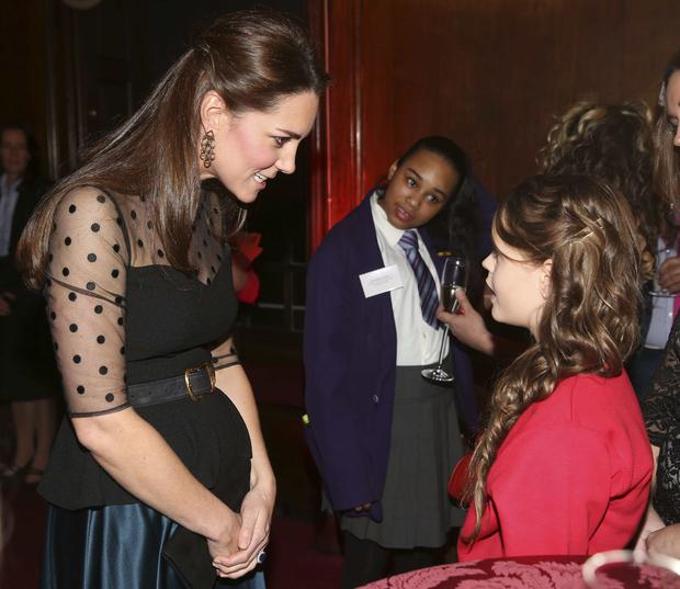 Catherine, Duchess of Cambridge meets a finalist in the child champion award, Georgia Alvey, from Cotsford Junior school in County Durham at the Place2be Wellbeing in Schools Awards Reception at Kensington Palace