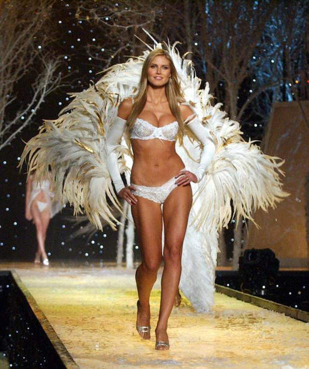 Heidi Klum wearing white Victoria's Secret heavenly lace unlined demi and bikini (Photo by KMazur/WireImage)