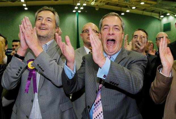 Nigel Farage, leader of the United Kingdom Independence Party (UKIP), cheers as it is announced that UKIP candidate Mark Reckless, the former Conservative Party member of Parliament for Rochester and Strood, won the by-election at Medway Park in Gillingham, southeast England, November 21, 2014 (REUTERS/Suzanne Plunkett)