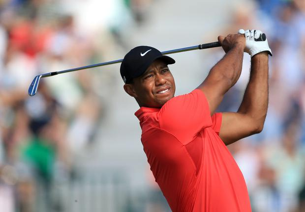 Almost five years on from the car crash which precipitated his fall from grace, Tiger Woods looks to have committed another major PR blunder with his attack on veteran journalist Dan Jenkins. Photo credit: Peter Byrne/PA Wire.