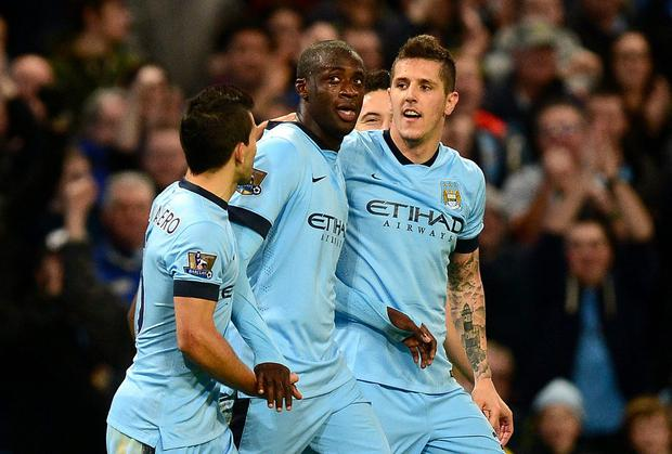 Manchester City's Yaya Toure (centre) celebrates scoring his teams 2nd goal against Swansea City with Stevan Jovetic (right) and Sergio Aguero (left). Photo credit: Martin Rickett/PA Wire