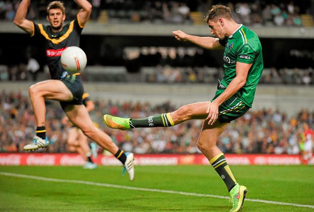 Pearse Hanley, Ireland, kicks 3 points despite the best efforts of Grant Birchall, Australia