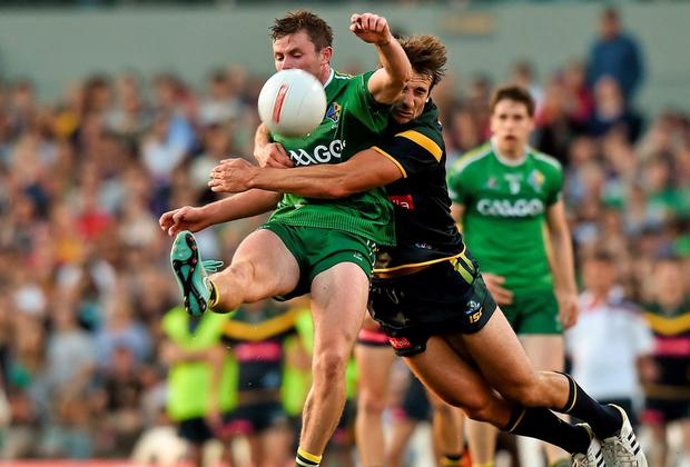 Pearse Hanley, Ireland, is tackled by Jobe Watson, Australia