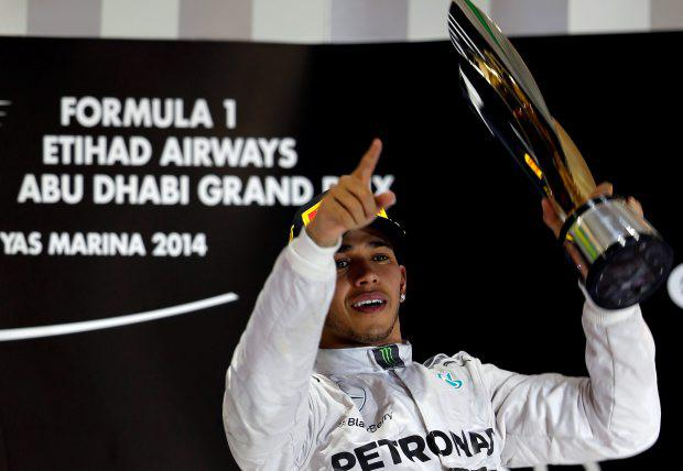 Mercedes Formula One driver Lewis Hamilton celebrates on the podium after winning the Abu Dhabi F1 Grand Prix at the Yas Marina circuit