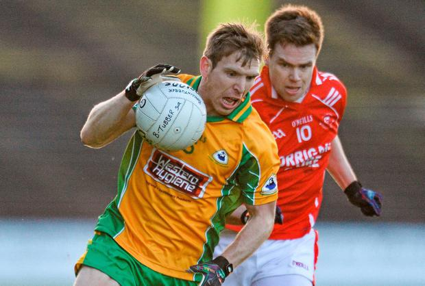 Corofin's Ciaran McGrath attempts to get away from Damien Coleman of Ballintubber. Picture credit: David Maher / SPORTSFILE
