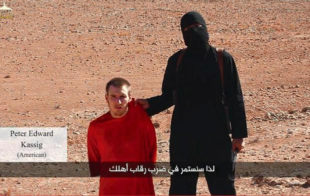 A militant threatening to behead former American soldier Peter Kassig during one of the gruesome Isil propaganda videos