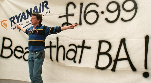 2003: Ryanair's chief executive Michael O'Leary gestures in front of a banner the company erected outside of rival British Airways' travel shop. Photo: SINEAD LYNCH/AFP/Getty Images
