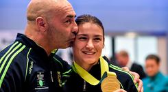 Katie with coach and father Pete Taylor pictured in Dublin Airport on their return from the 2014 AIBA Elite Women's World Boxing Championships in Jeju