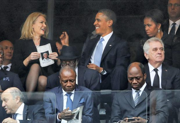 US President Barak Obama couldn't resist a 'selfie' after he was charmed by Danish PM Helle Thorning-Schmidt, while British PM David Cameron, inset, couldn't help getting in on the snap. AP Photo