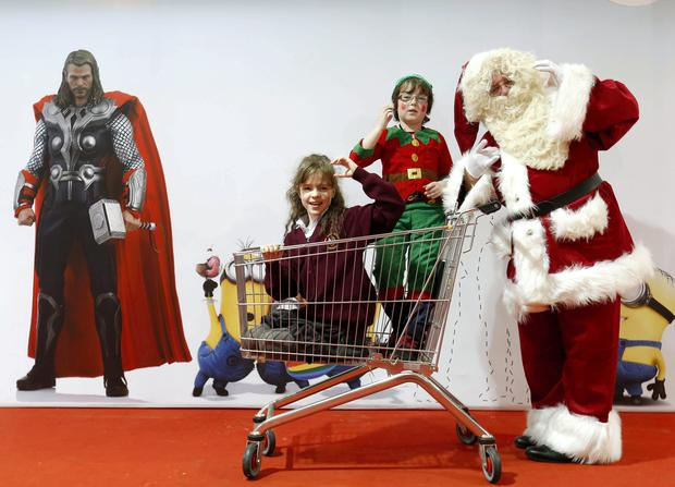 Quaid Cleland (10), Katie McGuanne (age 11) from Mid-west School for the Deaf in Limerick with Santa Claus