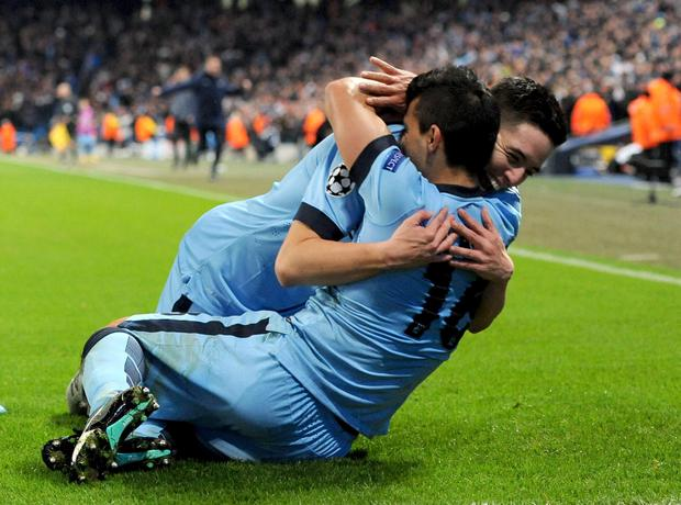 Manchester City's Sergio Aguero (right) celebrates scoring his sides third goal of the game alongside teammate Samir Nasri