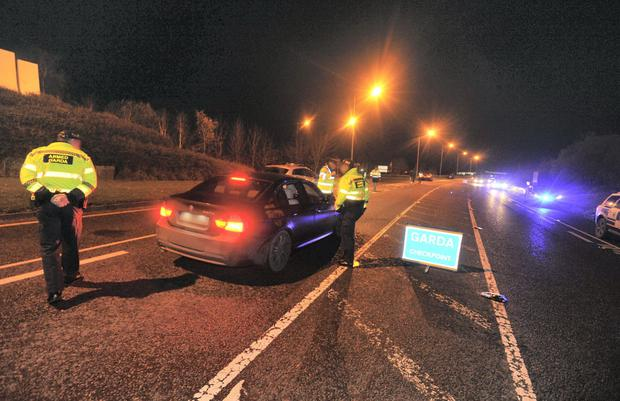Gardai stop a car which subsequently sped off at a checkpoint in carlow - the men were apprehended after a chase