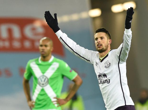 Everton's Kevin Mirallas celebrates after he scored a goal against Wolfsburg during their Europa League Group H soccer match in Wolfsburg, November 27, 2014
