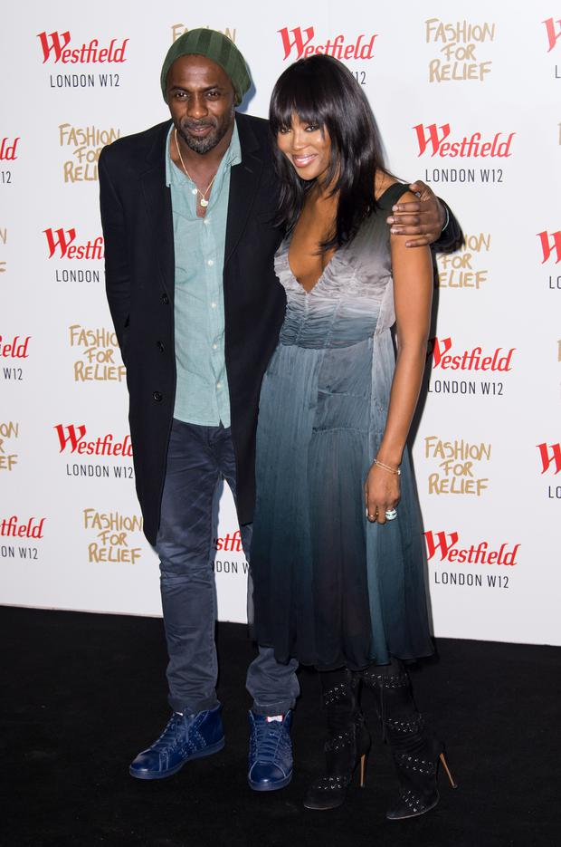 Idris Elba and Naomi Campbell attend the Fashion For Relief Pop Up launch party at Westfield shopping centre on November 27, 2014 in London, England. (Photo by Ian Gavan/Getty Images)