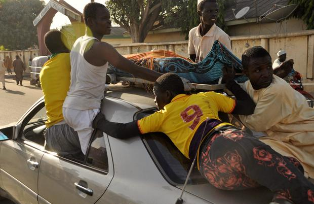 The remains of the Kano central mosque bombing victim is carried on the top of a car from the Murtala Mohammed specialist Hospital for burial according to Muslim rites, in Kano State REUTERS/Stringer