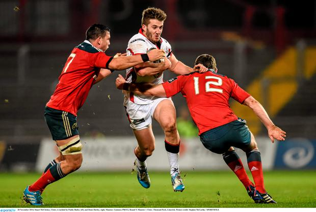 Stuart McCloskey, Ulster, is tackled by Paddy Butler, left, and Denis Hurley, right, Munster. Guinness PRO12, Round 9, Munster v Ulster. Thomond Park, Limerick. Picture credit: Stephen McCarthy / SPORTSFILE