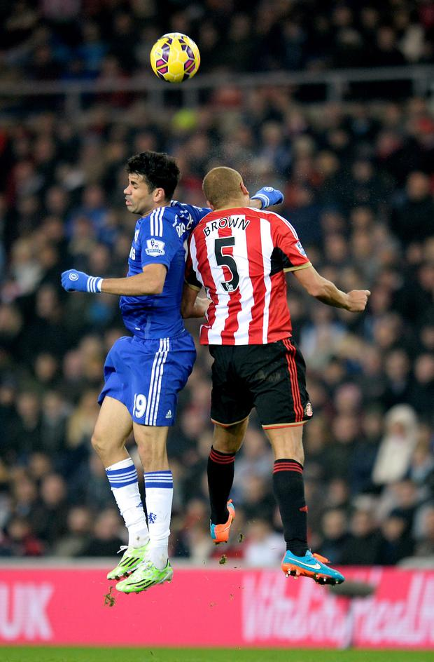 Chelsea's Diego Costa (left) battles for the ball with Sunderland's Wes Brown during the Barclays Premier League match at the Stadium of Light. Photo: Owen Humphreys/PA