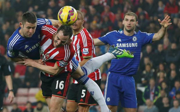 Sunderland's John O'Shea (2nd L) is challenged by Chelsea's Gary Cahill during their English Premier League soccer match at the Stadium of Light. REUTERS/Andrew Yates