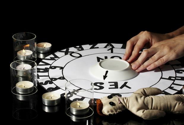 Spiritualistic seance by candlelight (stock photo)