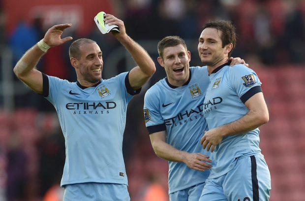 Manchester City's Frank Lampard reacts with team-mates James Milnerand Pablo Zabaleta after their Premier League victory over Southampton