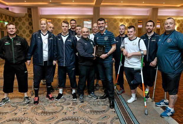 Roy Keane meets with members of the Irish Amputee Football Association before they departed for the Amputee World Cup in Mexico. Photo: David Maher / SPORTSFILE