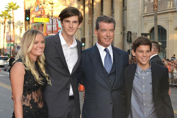 Guest, Dylan Brosnan, Pierce Brosnan and Paris Brosnan arrive at
