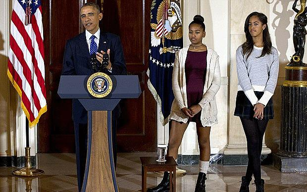 Sasha, 13, (left) and Malia, 16, (right) at the White House Thanksgiving turkey pardon