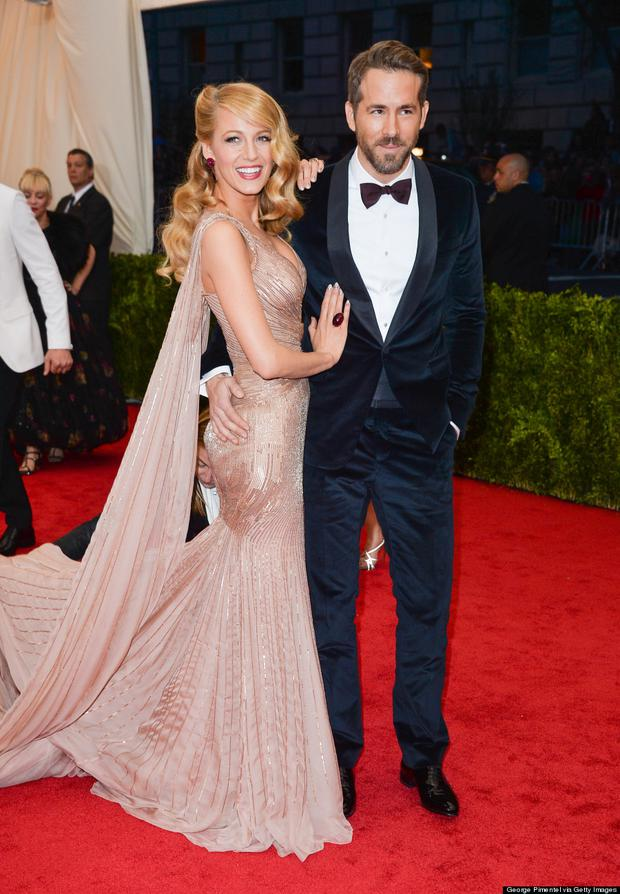 It's been two years and we've never even seen a glimpse of the dress! Blake Lively and Ryan Reynolds wed in Paris after two years of dating and Martha Stewart Weddings covered the party's decor but not the style.