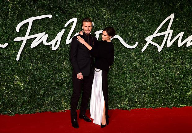 David Beckham and Victoria Beckham arrive together. Photo: Ian West/PA Wire