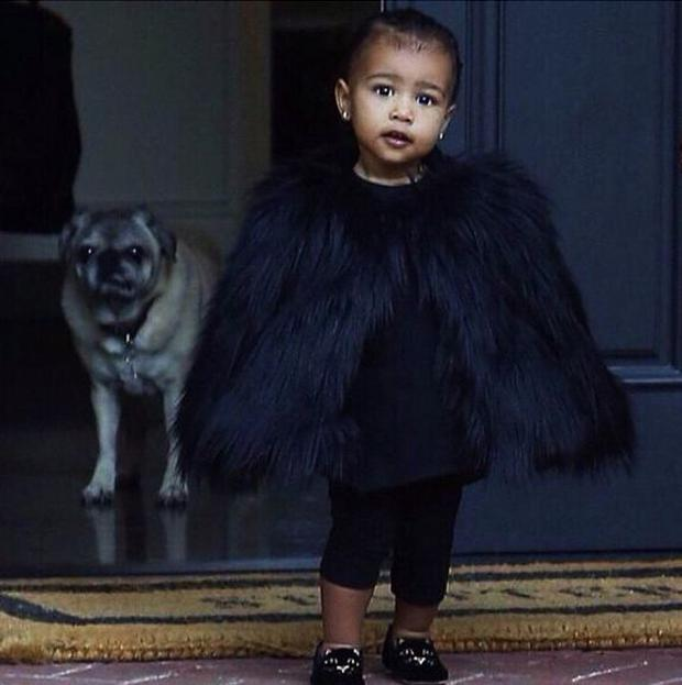 Here she is in a faux fur cape and Charlotte Olympia pumps at 18 months old.
