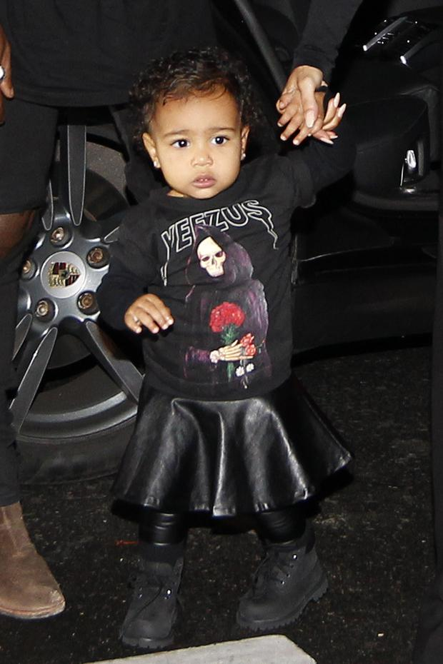 North adds her own twist to a leather skater skirt and Yeezus t-shirt because she isn't your average toddler.