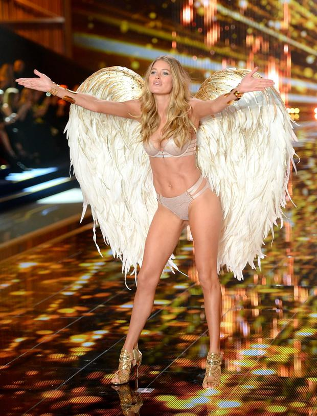 Doutzen Kroes on the catwalk during the Victoria's Secret fashion show at Earls Court. Photo: PA