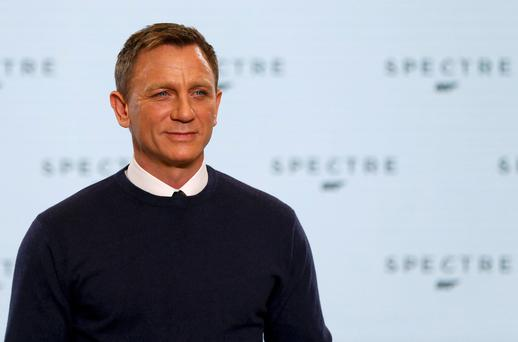 Actor Daniel Craig poses on stage during an event to mark the start of production for the new James Bond film
