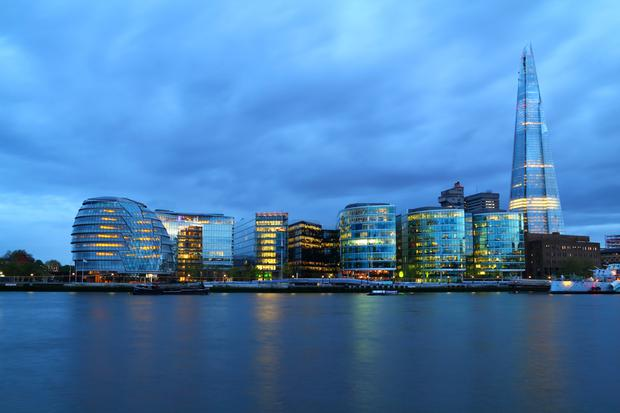 London City Hall at night, panoramic view from river.