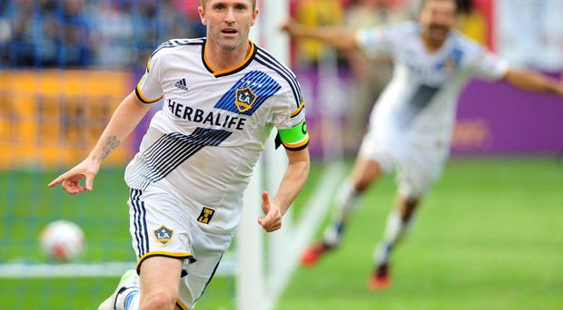 Los Angeles Galaxy forward Robbie Keane (7) celebrates after scoring