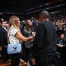 Singer Beyonce and Husband Jay-Z greets The Duchess of Cambridge in the game of the Cleveland Cavaliers against the Brooklyn Nets at the Barclays Center on December 8, 2014 in the Brooklyn borough of New York City.