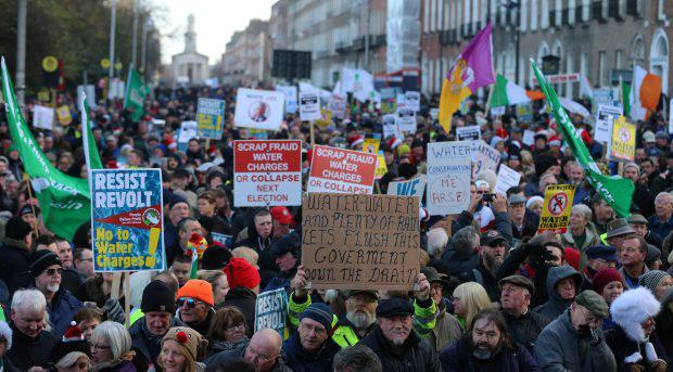 Crowds gather for the Right2Water anti-water charges protest outside Leinster House in Dublin Niall Carson/PA Wire