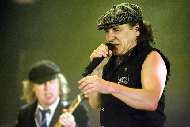Brian Johnson, right, lead singer of Australian rock band AC/DC, and guitarist Angus Young, left