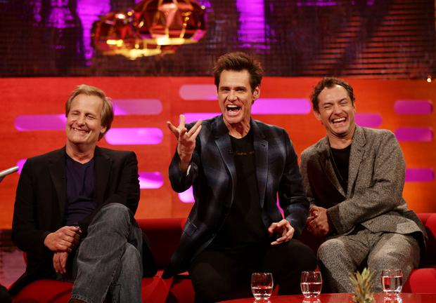 Guests (left to right) Jeff Daniels, Jim Carrey and Jude Law during filming of the Graham Norton Show