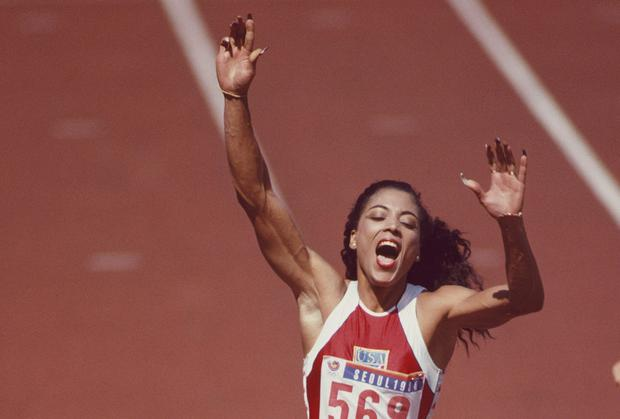 Florence Griffith-Joyner celebrates winning gold in the Women's 100m metres at the 1988 Olympics