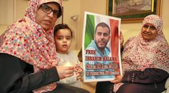 Sisters Fatima and Nosayba Halawa and Sundas (3), who were holding a candlelight protest outside the Egyptian Embassay in December 2014