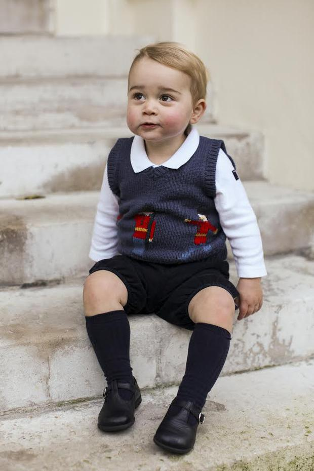 Prince George poses for his official Christmas photograph.