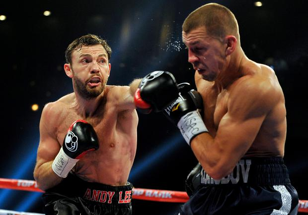 Andy Lee (L) throws a left at Matt Korobov during their fight for a vacant WBO middleweight title at The Chelsea at The Cosmopolitan of Las Vegas on December 13, 2014 in Las Vegas, Nevada. (Photo by David Becker/Getty Images)