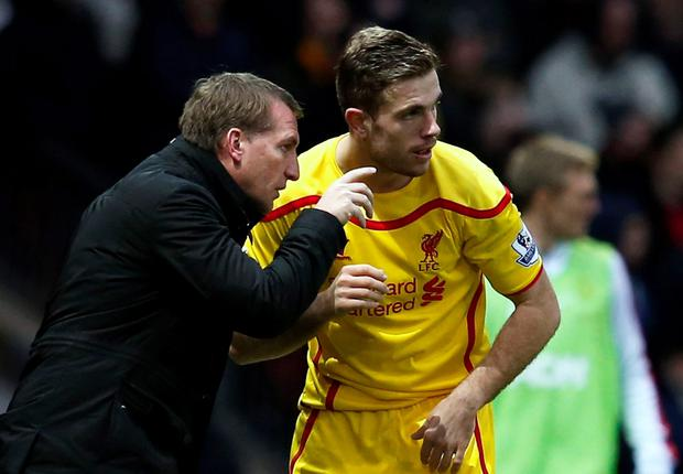Liverpool manager Brendan Rodgers (L) instructs Jordan Henderson
