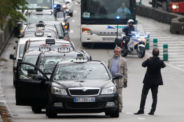 France bans taxi app after 'go-slow' protest brings chaos