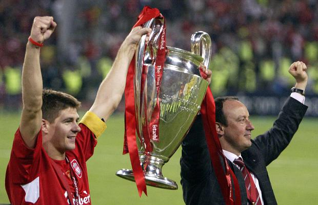 Liverpool's captain Steven Gerrard holds the Champions League trophy with former Liverpool boss Rafael Benitez at the Ataturk Stadium in Istanbul, 2005. MUSTAFA OZER/AFP/Getty Images