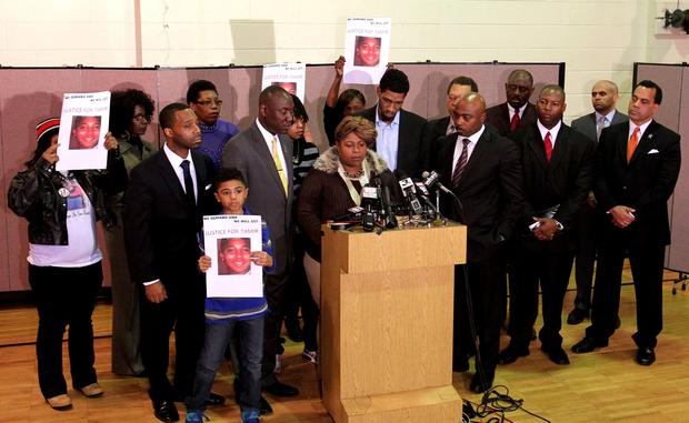 Samaria Rice, the mother of Tamir Rice, the 12-year old boy who was fatally shot by police last month while carrying what turned out to be a replica toy gun, speaks while surrounded by attorneys, local leaders and family during a news conference at the Olivet Baptist Church in Cleveland, Ohio (REUTERS/Aaron Josefczyk)