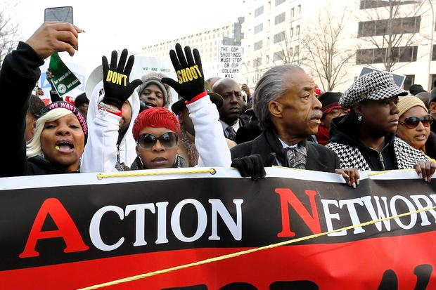 (From 2nd L to R) Lesley McSpadden, mother of Michael Brown, Rev. Al Sharpton, Sybrina Fulton, mother of Trayvon Martin, and Samaria Rice, mother of Tamir Rice, lead the national Justice For All march against police violence, in Washington December 13. Samaria Rice said that her 12-year-old son, Tamir Rice, was shot before he could respond to orders, and had long ago had 'The Talk' with her children - as black parents call warnings to their children to comply with police or risk danger (REUTERS/Jonathan Ernst)